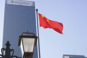 Chinese-flag-and-skyscraper-Fredrik-Rubensson