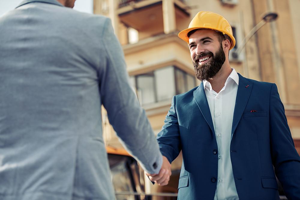 Construction Estimator Shaking Hands